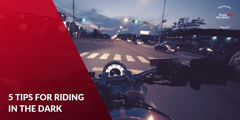 Riding a motorcycle at night.