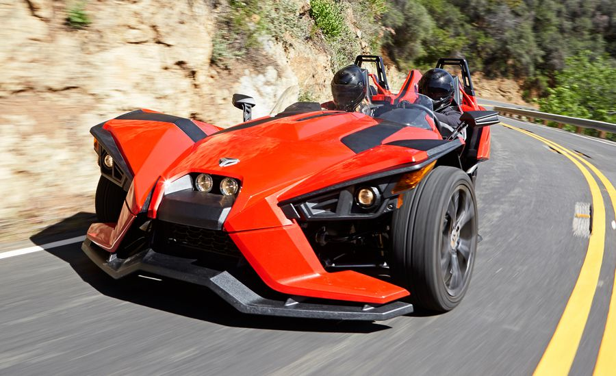 Red slingshot three wheeled motorcycle