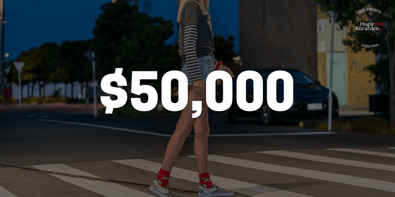 $50,000 for client who was struck while crossing the street.