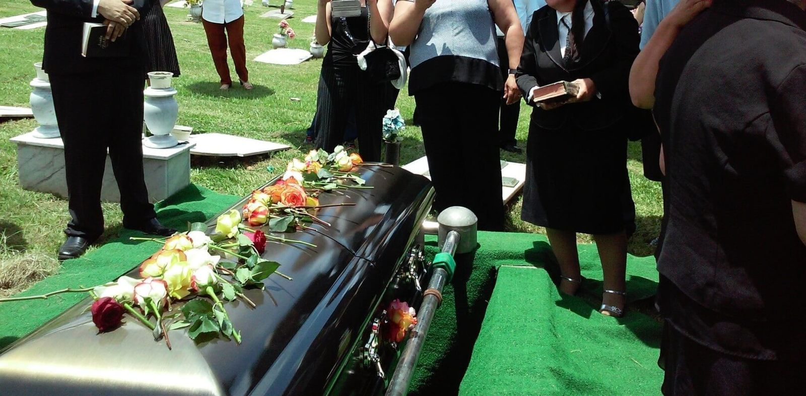 flowers on coffin after wrongful death case