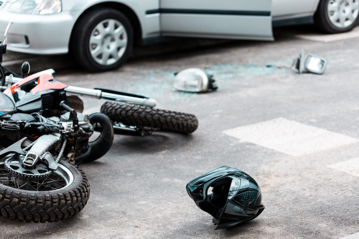 Wreckage from motorcycle crash accident with car causing Injury