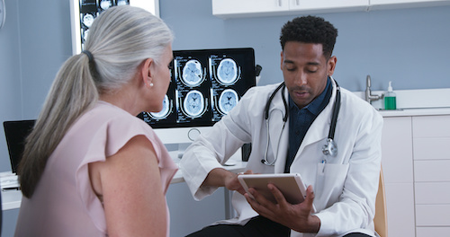 Woman getting her closed TBI checked out by a doctor after consulting with a brain injury lawyer
