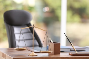 Desk of a Local Attorney With the Scales of Justice in Myrtle Beach Derrick Law Firm