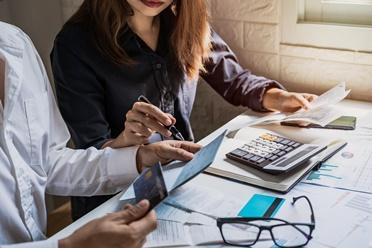 Couple Looking at Bank Accounts