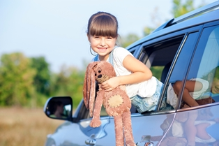 Child Playing Around in a Parked Car
