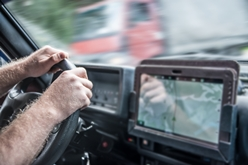 Close-Up View of a Truck Driver Using an Electronic Device