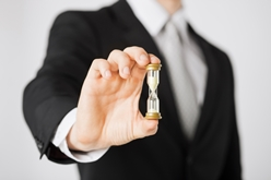 Lawyer Holding a Sand Timer in His Hand