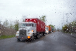 Semi-Truck Traveling on a Rainy Day