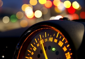Close-Up View of a Speeding Car's Speedometer