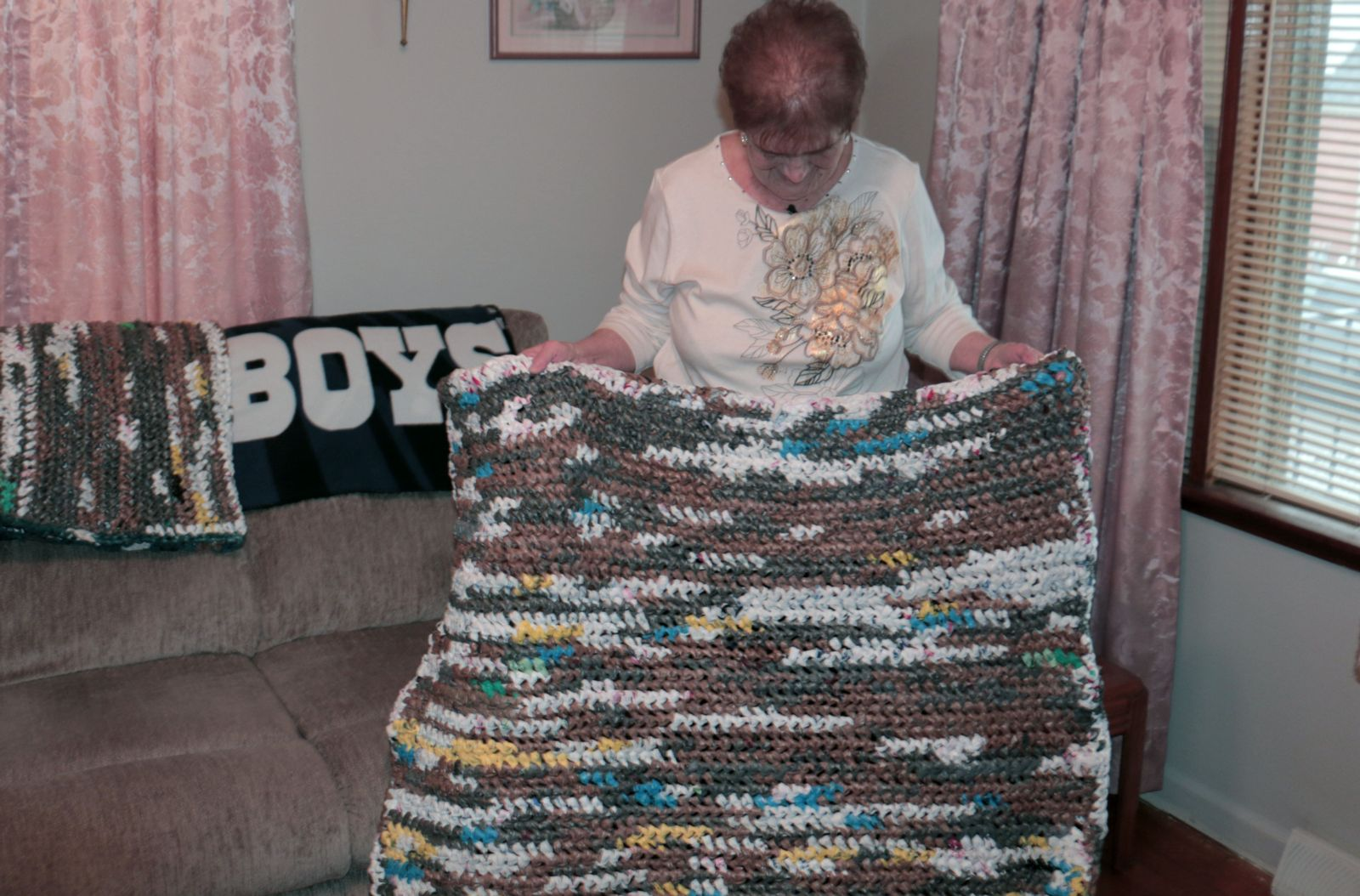 Marsha Whisler and her crocheted mat