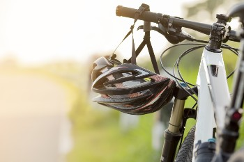 Learn how not wearing a helmet affects your bike accident claim.