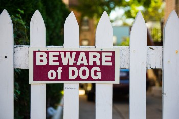 Beware of dog signs can be a defense in a dog bite claim.