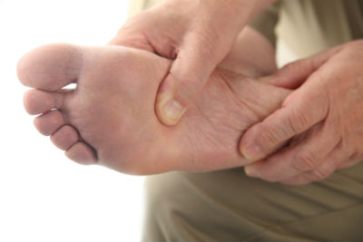 A home foot massage with vaseline can help prevent cracked feet