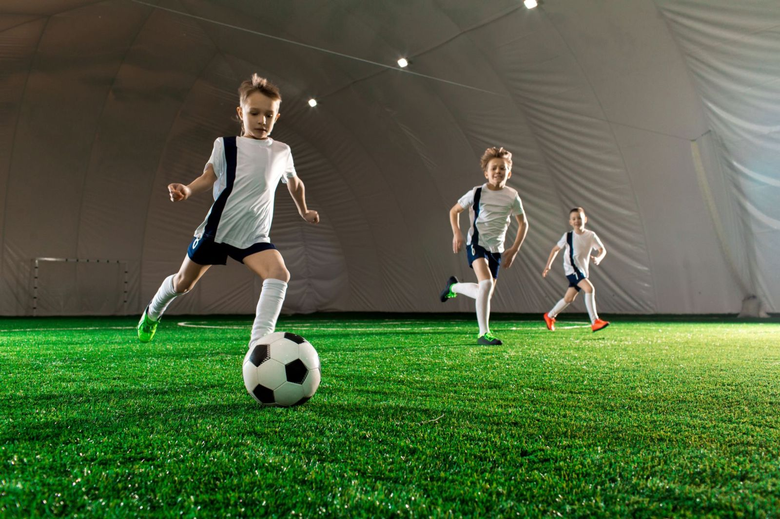 Playing on astroturf puts your little soccer player at greater risk for a painful turf-toe injury, which usually develops over time