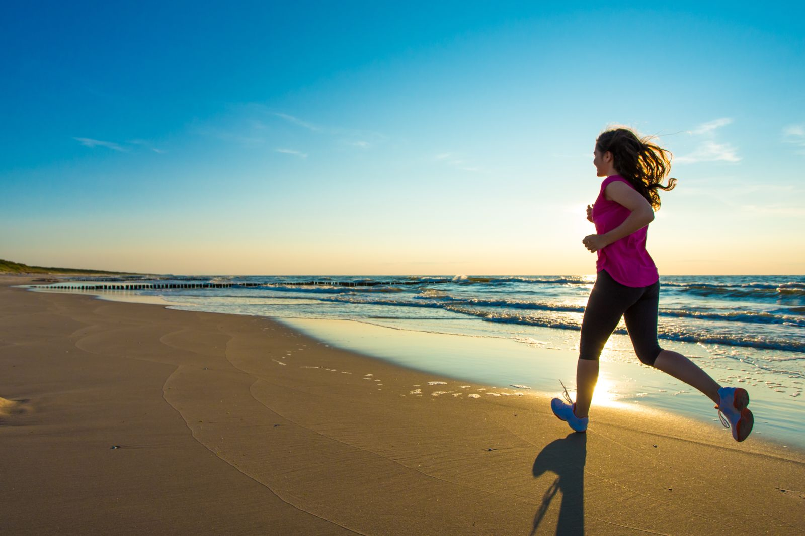 Running in the summer is great on the beach, but watch out for dehydration when the humidity rises.