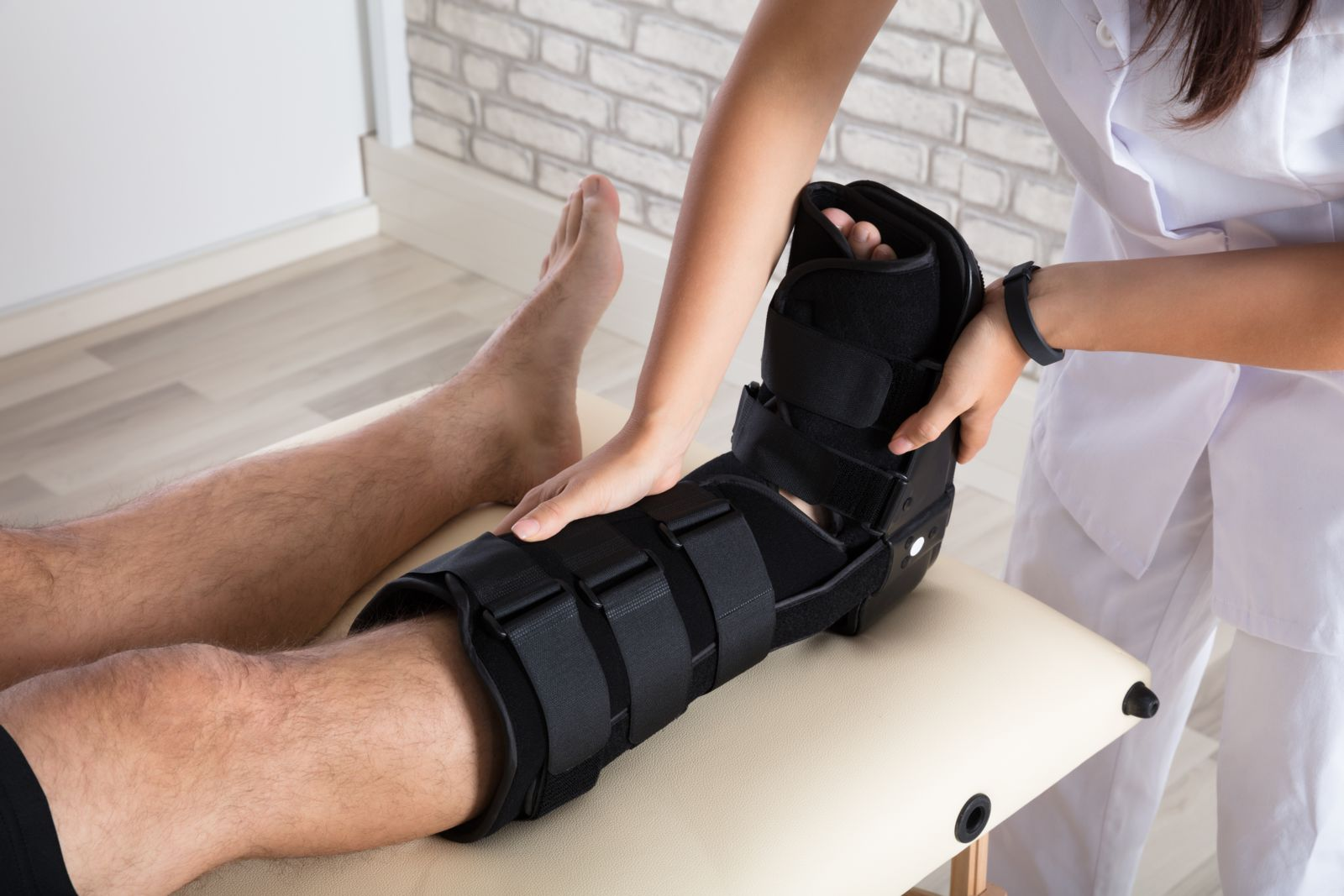 Podiatrists treat a broken foot with a walking boot for an easier recovery