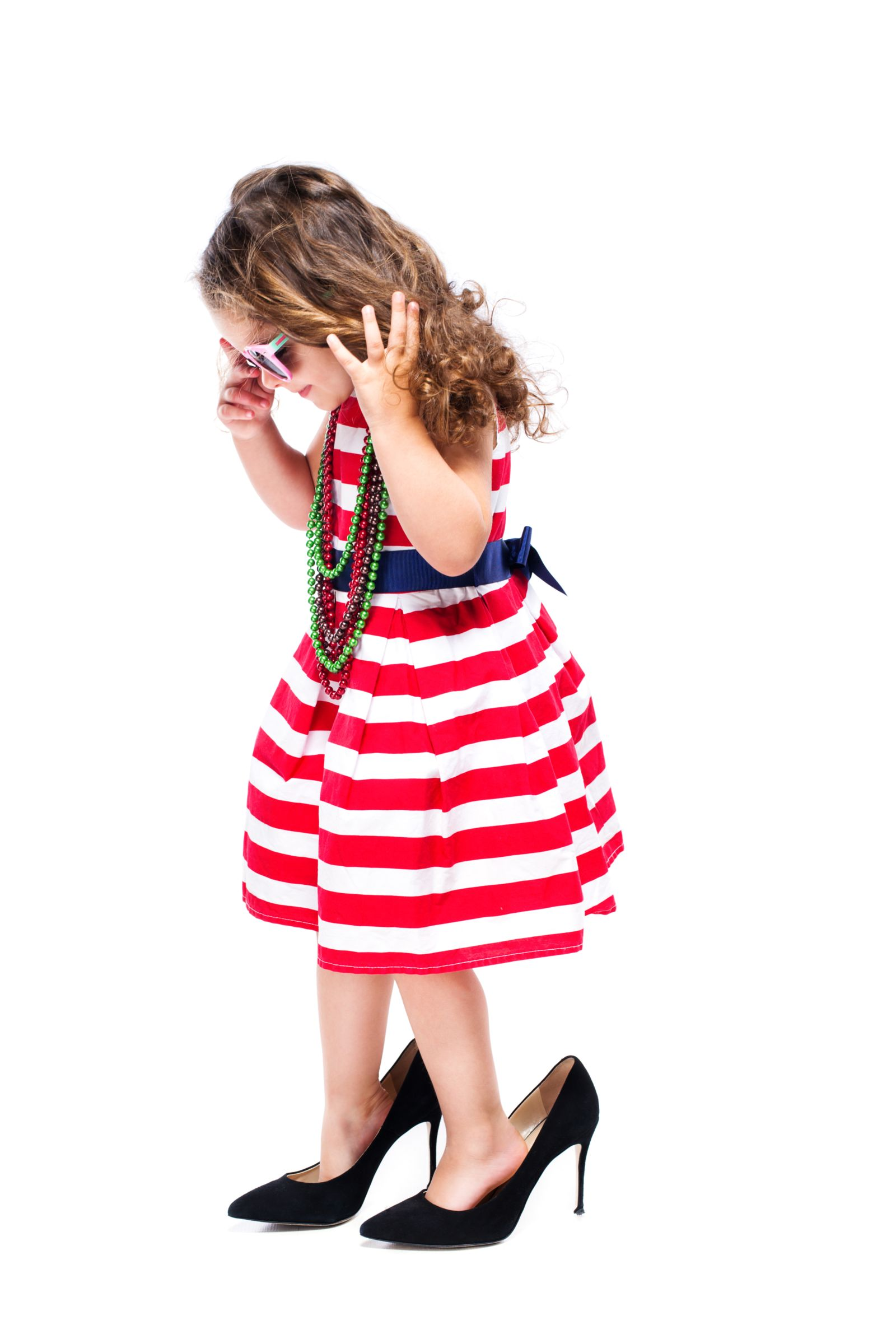 Sure, this is a cute look...but heels outside of dressup are damaging to a child's feet