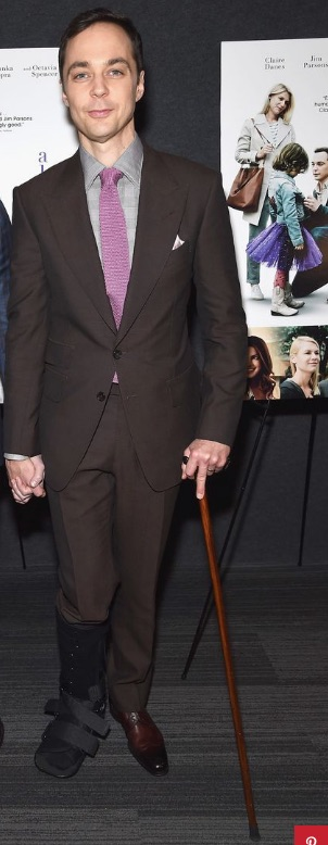 Jim Parsons walks with a boot and cane after breaking a bone in his foot