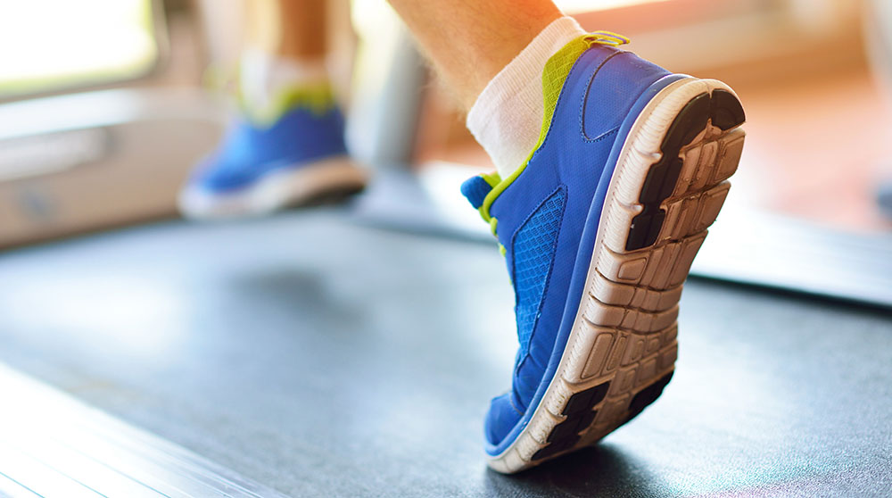 Running on a treadmill in orthotics by Houston podiatrist