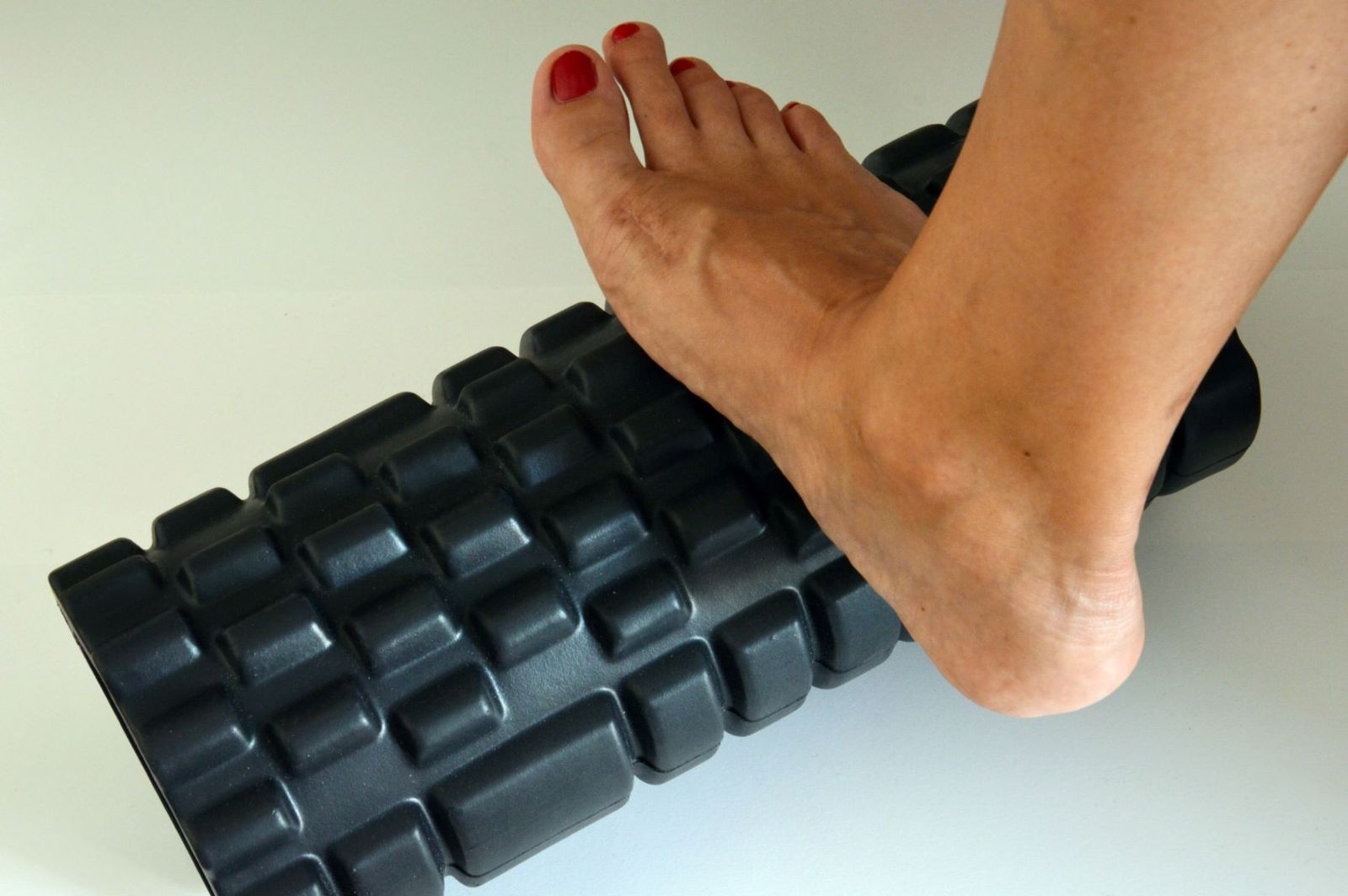 When you first start foam rolling your feet, gentle pressure is best to avoid injury