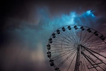 Amusement Park Ride With Dark Skies