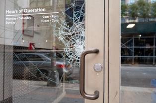 Broken Glass on the Front Door of a Commercial Building