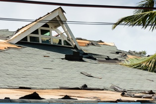 Office Building Roof That Has Been Damaged by a Severe Windstorm
