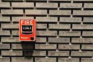 Fire Alarm on a School Wall