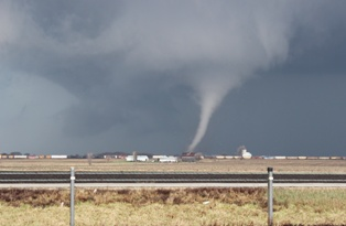 Tornado Touching Down on the Ground and Headed Towards a School