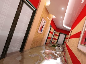 Flood waters flow through a hotel corridor