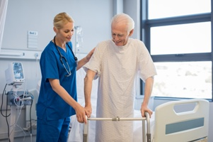nurse helping patient with walker The Hart Law Firm