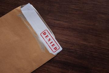 Denial Paperwork in an Envelope