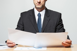 A Lawyer Comparing Paperwork for Class Action and Mass Tort Cases