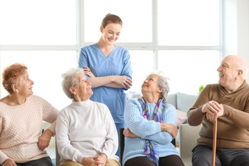 Nursing Home Worker With Residents
