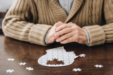 An Alzheimers Patient Working a Puzzle