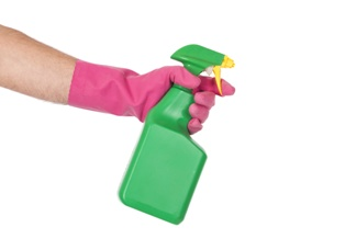 A Consumer Spraying Roundup in a Spray Bottle