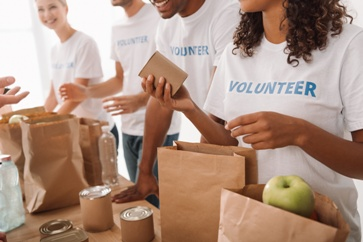 Group of Volunteers Packing Food