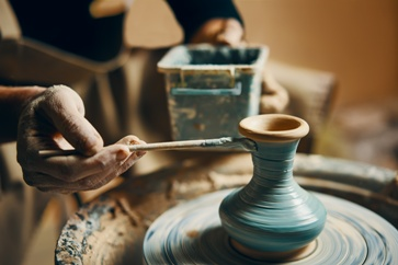 Woman Paintng a Piece of Pottery