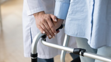 Woman With a Musculoskeletal Disorder Using a Walker