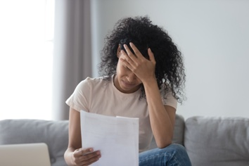 Woman Looking at a Warning Letter for Valsartan