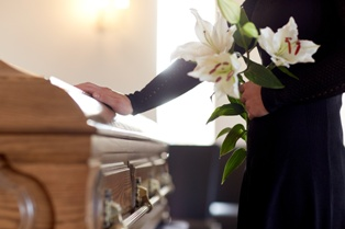Woman at a Funeral for Her Husband After a Work Fatality in Massachusetts