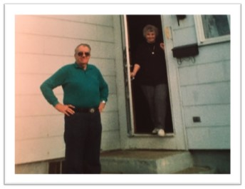 Jackie Bedard's grandmother and grandfather standing in front of house