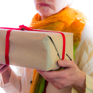 Older woman holding package