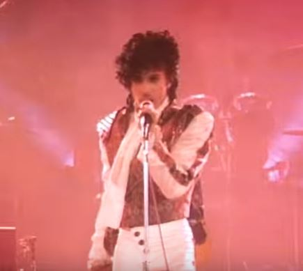Prince singing at concert