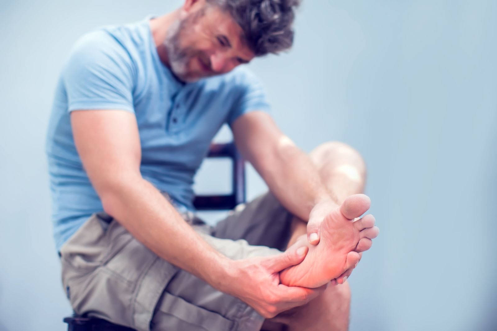 Man holding foot in pain