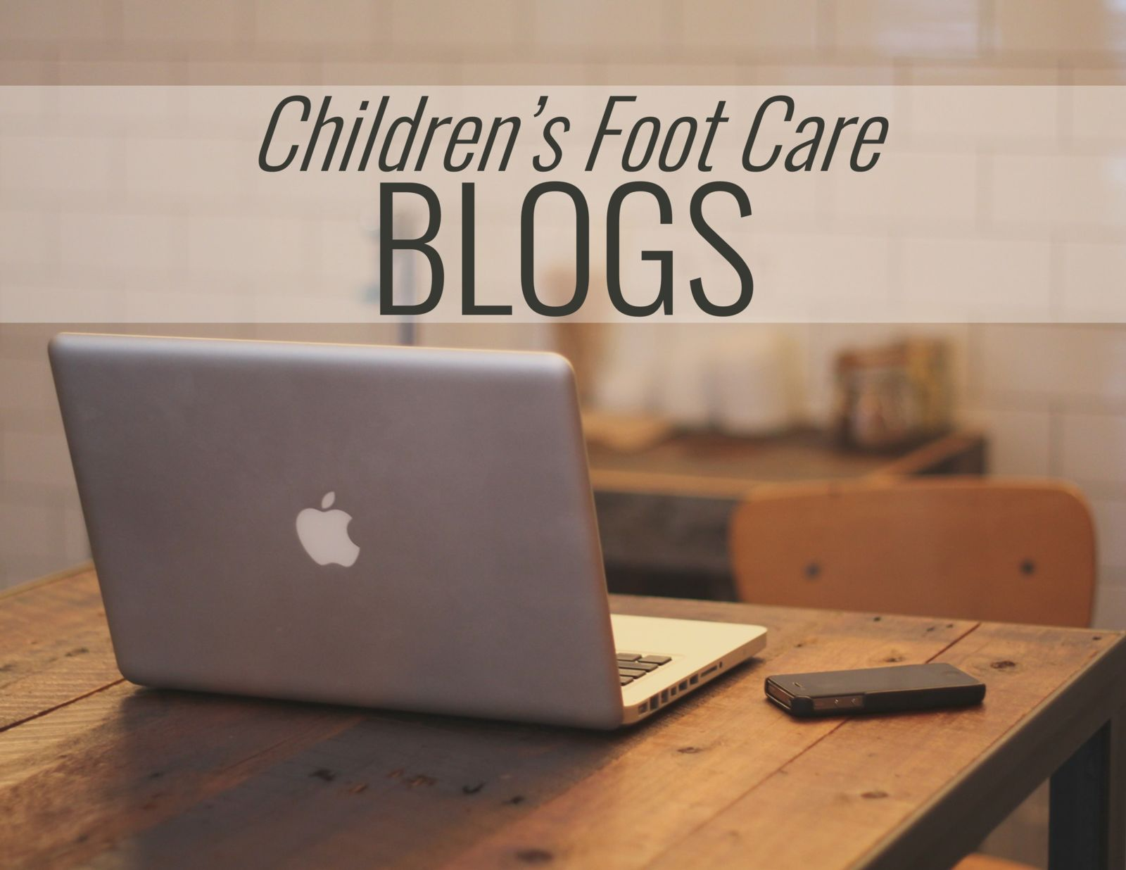 computer on a desk and the words: Children's Foot Care Blogs