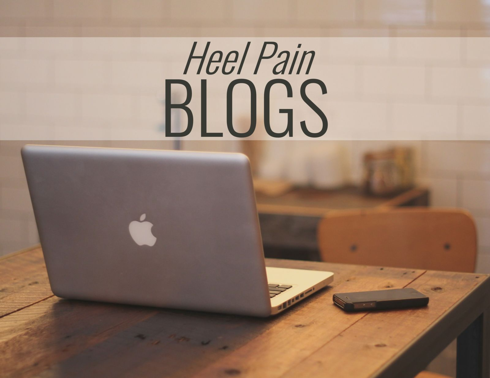 computer on a desk and words: Heel Pain Blogs