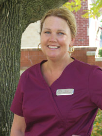 Photo of Karyn P, a medical assistant at PPFAC in front of a tree