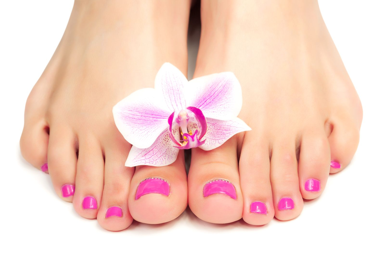 Picture of female feet with flower on it after a pedicure