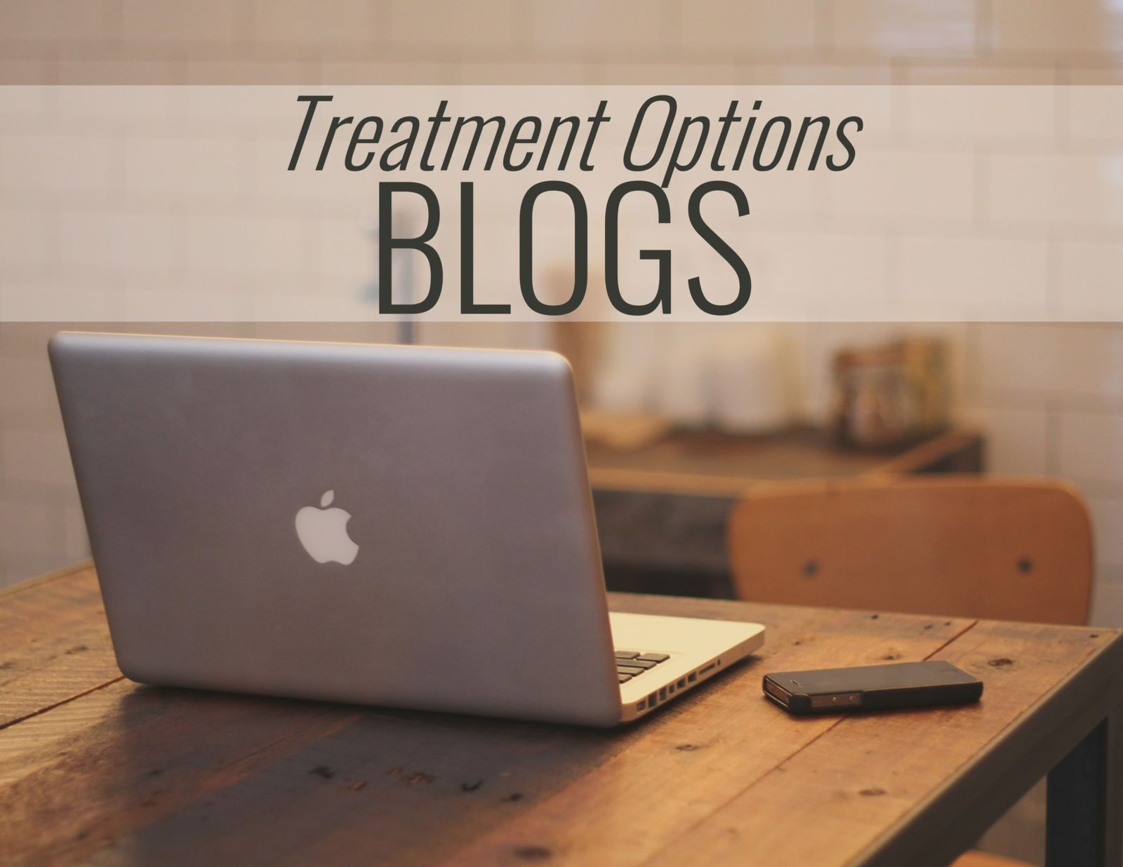 computer on a desk and the words; Treatment Options Blogs